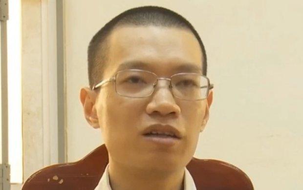 Đối tượng Nguyễn Anh Tú tại cơ quan điều tra. Ảnh ANTV