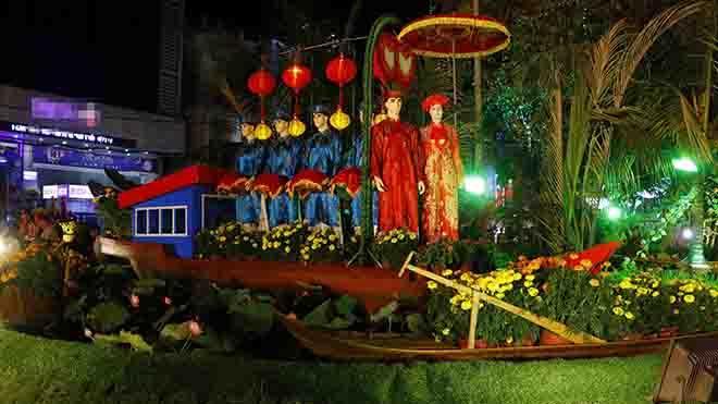 Tiểu cảnh tái hiện đám cưới ở vùng quê Nam Bộ tại đường hoa nghệ thuật xuân Mậu Tuất tại Cần Thơ. Ảnh: Thanh Liêm - TTXVN