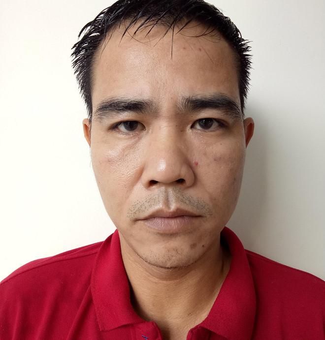 Lê Minh Tuấn tại cơ quan điều tra. Ảnh: N.T.