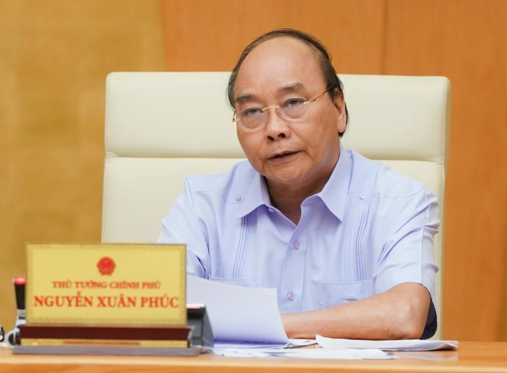 Thủ tướng Nguyễn Xuân Phúc yêu cầu Đà Nẵng thực hiện giãn cách xã hội từ 0h ngày 28/7. Ảnh: VGP.