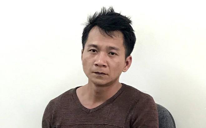 Vương Văn Hùng tại cơ quan công an.