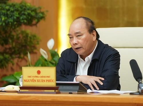 Thủ tướng Nguyễn Xuân Phúc chủ trì cuộc họp Thường trực Chính phủ về giải pháp bình ổn giá thịt lợn. Ảnh: VGP/Quang Hiếu.