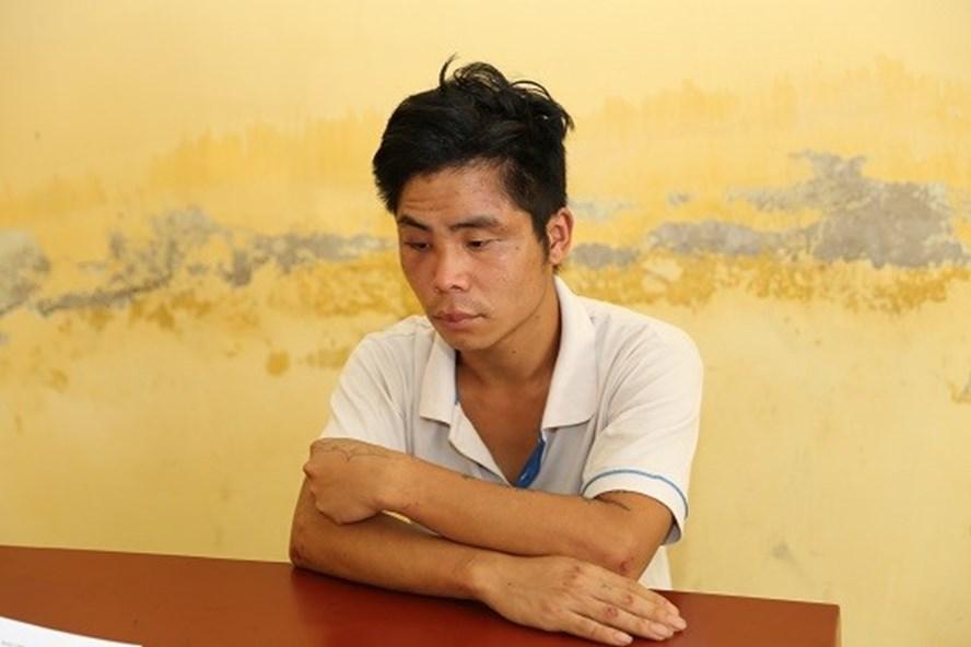Đối tượng Nguyễn Quang Thuật tại cơ quan công an. Ảnh: CAHD.
