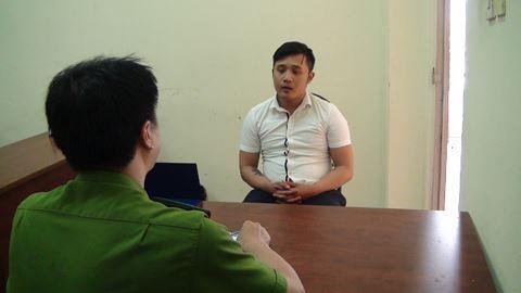 Nguyễn Hữu Vinh tại cơ quan công an. Ảnh: ANTĐ