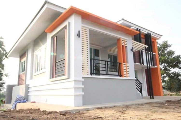 Biệt thự được sơn màu sắc nhẹ nhàng, kết hợp với màu cam khiến nó nổi bật hơn. Ảnh: Facebook.
