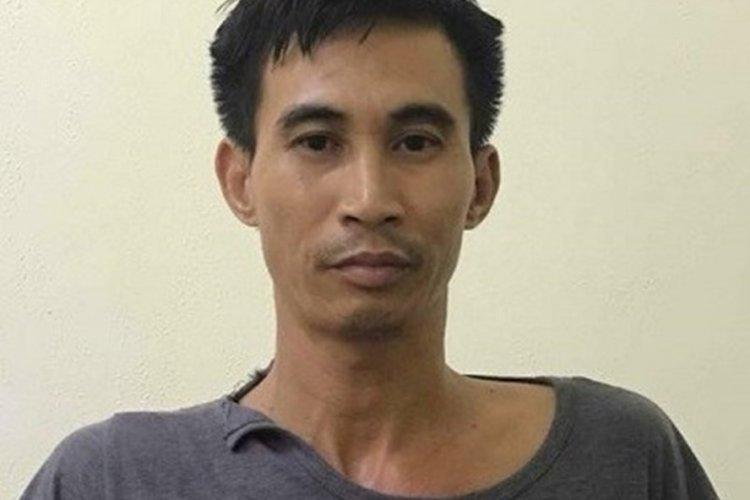 Đinh Công Tráng tại cơ quan công an. Ảnh: báo Dân Việt.