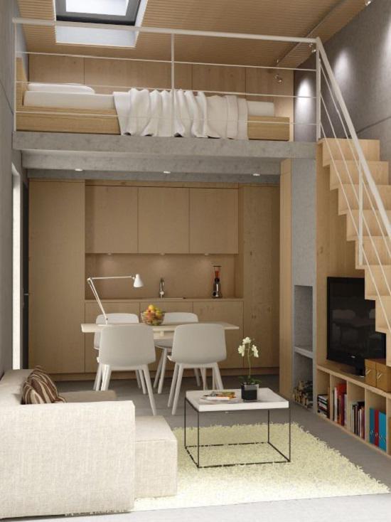 Phòng khách, bàn ăn và bếp nhỏ bố trí ở tầng 1, trong khi gác lửng nhỏ nhắn được sử dụng làm phòng ngủ ấm cúng.