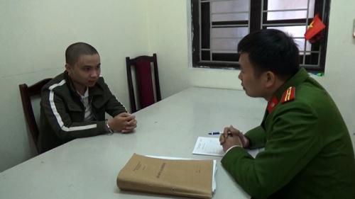 Nguyễn Đức Huy tại cơ quan công an - Ảnh: Thanh Niên