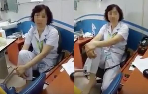 Hình ảnh BS M. gác chân đối thoại với người nhà bệnh nhân. Ảnh cắt từ clip