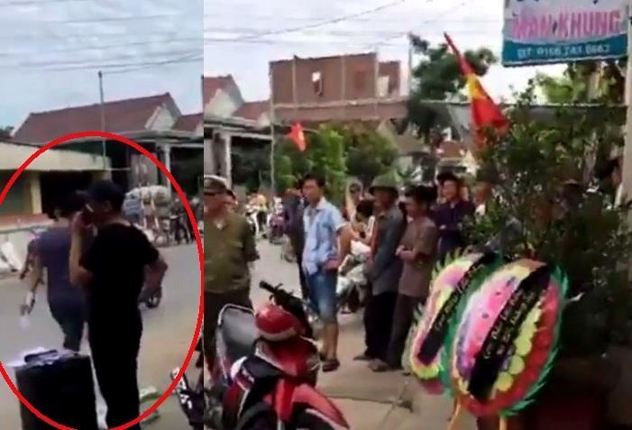 Đối tượng cầm micro gọi tên trưởng công an xã (ảnh chụp clip).