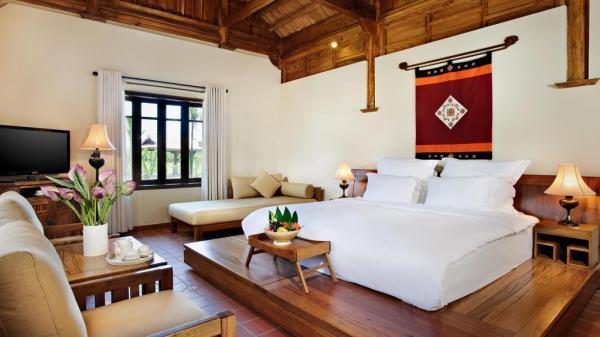 Phòng ngủ được trang hoàng theo phong cách Bắc Bộ với trang bị điều hòa không khí. (Nguồn: dulichtoday.com.vn)