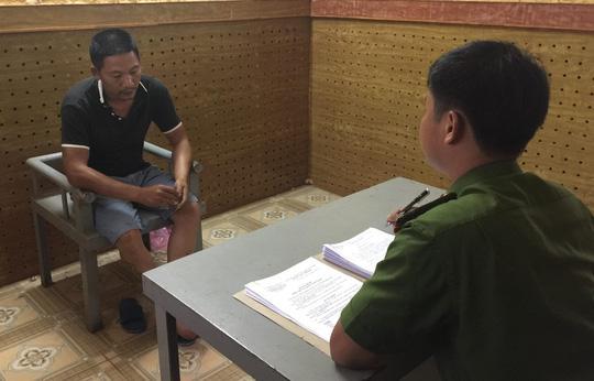 Đối tượng Nguyễn Thành Nhân tại cơ quan điều tra - ảnh Công an cung cấp