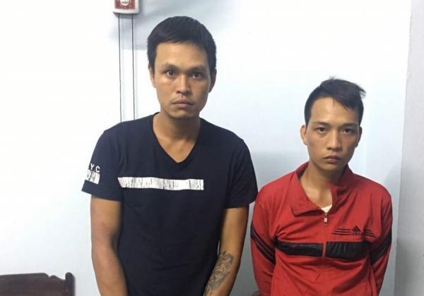 Hai đối tượng Nguyễn Hải Nam và Đặng Văn Bình tại cơ quan điều tra (ảnh: công an cung cấp)