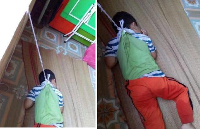 Hình ảnh bé trai bị buộc vào cửa sổ gây bức xúc dư luận. Ảnh: Đời Sống Việt Nam.