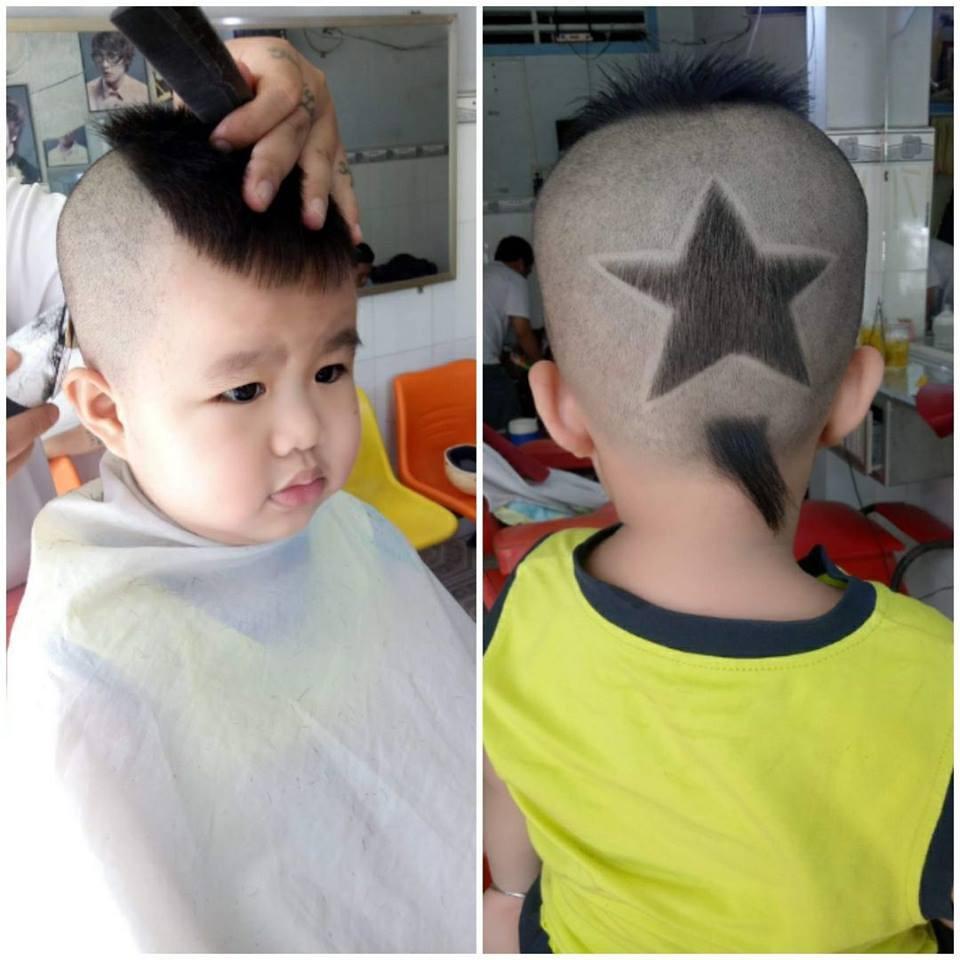 Cả những cậu bé cũng được bố dẫn đi cắt kiểu tóc ấn tượng hình ngôi sao.