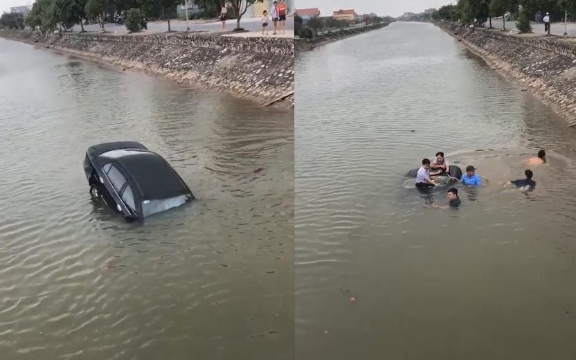Người dân hợp sức đ ập vỡ kính giải cứu tài xế.