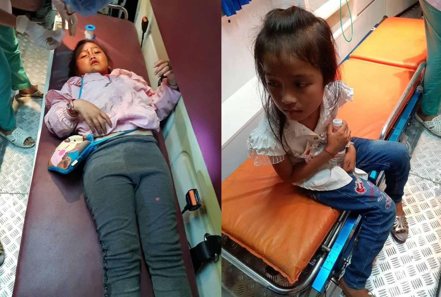 Các em nhỏ bị mảnh kính găm vào người, đang được điều trị tạiBV Trung ươngHuế. Ảnh: Quang Thành