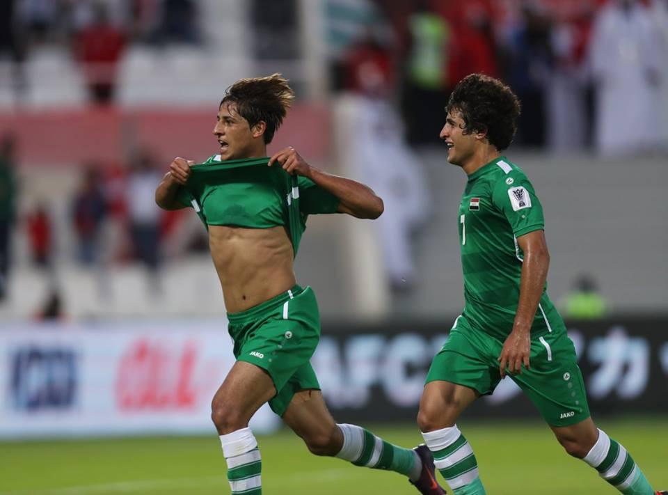 Mohanad Ali (trái) mở tỷ số cho Iraq. Ảnh: AFC.