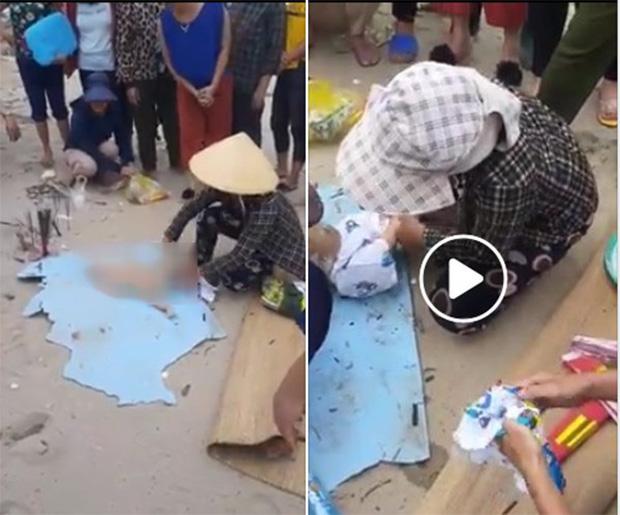 Hình ảnh c ắt từ clip do người dân ghi nhận sự việc phát hiện t hi th ể  một cháu bé.