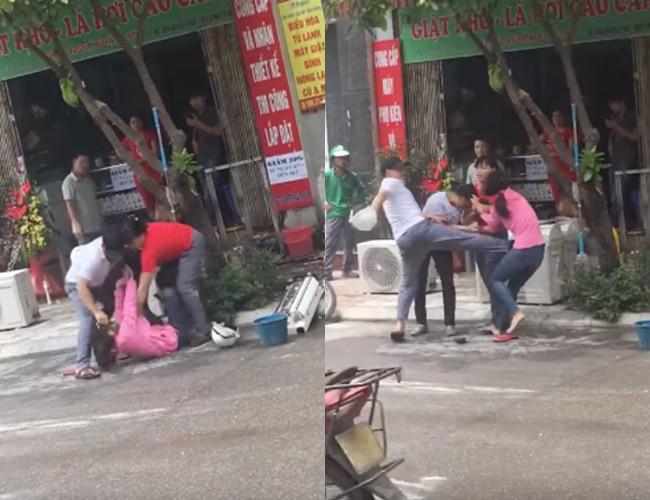Hình ảnh người chồng đạp vào bụng vợ để bênh cô nhân tình ngay ngoài đường. Ảnh cắt từ clip