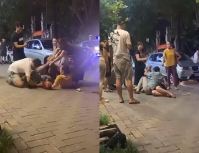 Người đàn ông ra sức che chắn cho người phụ nữ lạ trước những pha tấn công của vợ con.