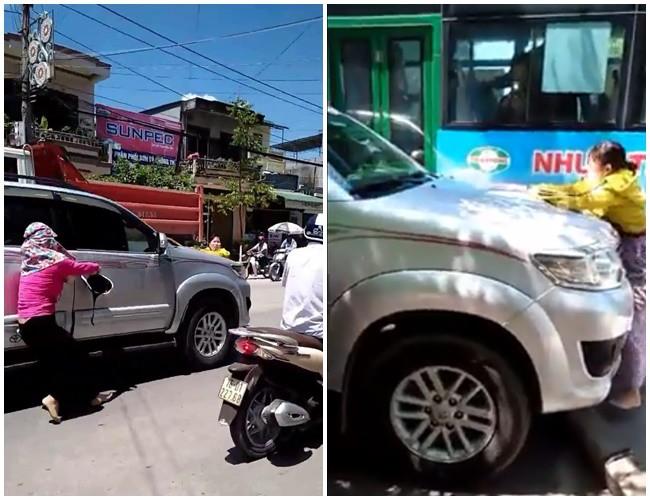 Hình ảnh vợ cùng người thân chặn chiếc ô tô khi bắt gặp chồng chở bồ nhí trên phố.